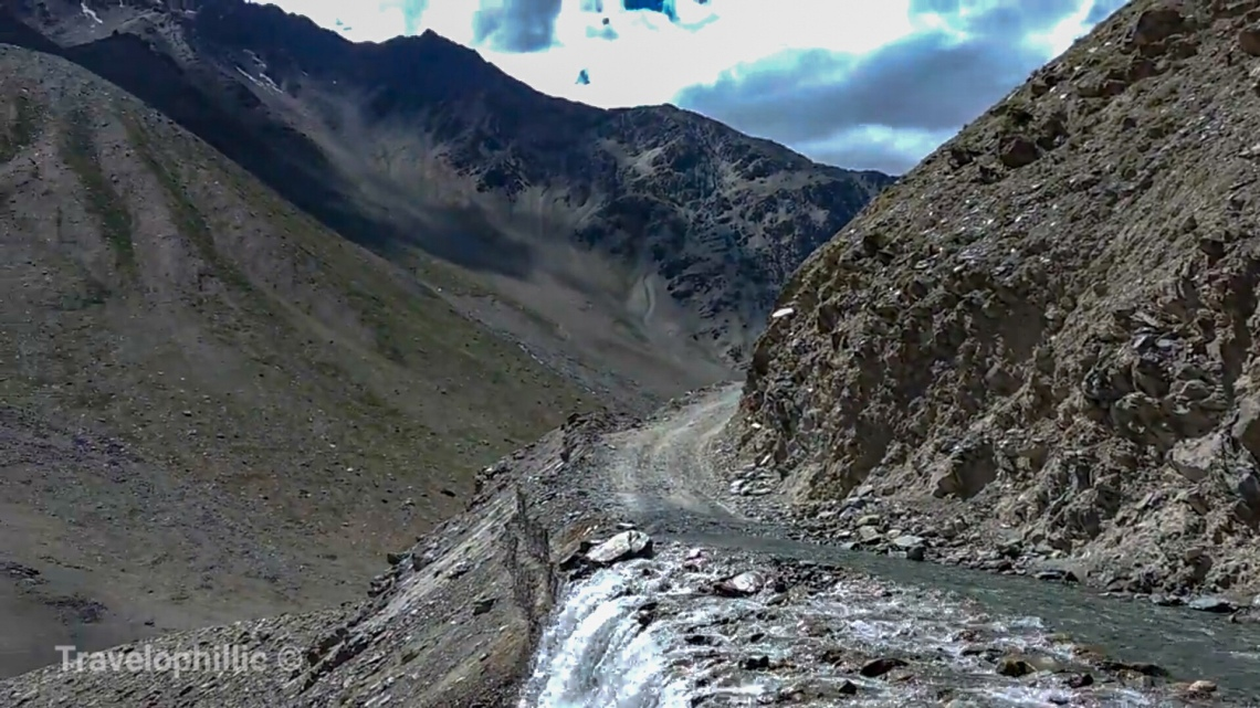 Treacherous roads running over glacial water flowing