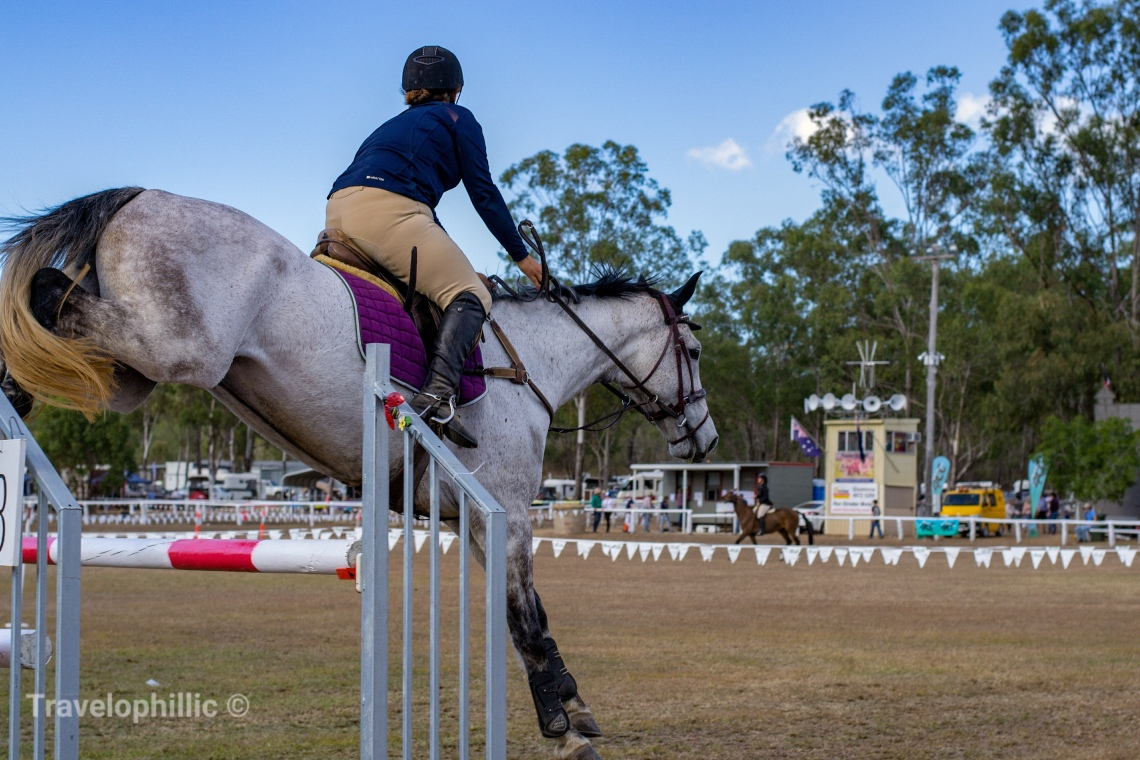 Jump over an oxer by a horse rider
